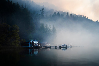 Smoke shrouds a cabin as a wildland fire burns along East Beach Road on the northern shore of Olympic National Park's Lake Crescent on July 30, 2020. (Jesse Major)