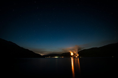 A wildland fire burns along East Beach Road on the northern shore of Olympic National Park's Lake Crescent on July 29, 2020. (Jesse Major)