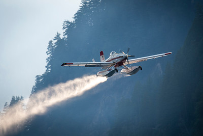 A plane picks up water to drop on a wildland fire along East Beach Road on the northern shore of Olympic National Park's Lake Crescent that grew to more than 63 acres on July 30, 2020. (Jesse Major)