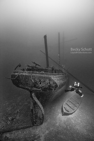 Diver illuminates the yawl boat that the crew would have needed to survive the late november storm that send the crew and their ship to it's final resting place on the bottom of Lake Huron.  The 3-masted schooner sits intact and was discovered over a century after it went missing.