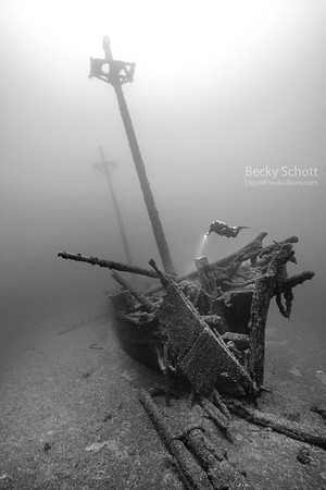 Diver inspecting Kyle Spangler bow damage