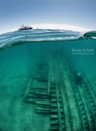 Diver explores the remains of the steam barge Monohansett