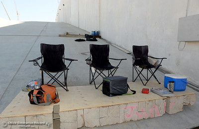 Chairs and lunchboxes are seen on a leveling platform on the spillway during a tour of ongoing construction at the Lake Oroville Dam Spillway area Wednesday, July 11, 2018.  (Bill Husa -- Enterprise-Record)