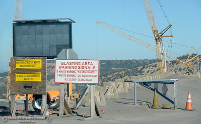 Warning signs pertaining to blasting signals are seen during a tour of ongoing construction at the Lake Oroville Dam Spillway area Wednesday, July 11, 2018.  (Bill Husa -- Enterprise-Record)