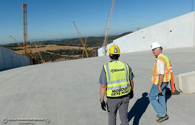 Jeff Petersen, Senior Vice President Kiewit Executive Project Director left and Tony Meyers, DWR project manager walks down the spillway during a tour of ongoing construction at the Lake Oroville Dam Spillway area Wednesday, July 11, 2018.  (Bill Husa -- Enterprise-Record)