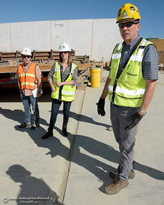 Left to right, Matt Notley, Vice President of Edelman, Erin Mellon, DWR Assistant of Public Affairs and Jeff Petersen, Senior Vice President Kiewit Executive Project Director walk around the spillway during a tour of ongoing construction at the Lake Oroville Dam Spillway area Wednesday, July 11, 2018.  (Bill Husa -- Enterprise-Record)