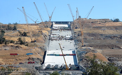 Lots of cranes and activity can be seen during a tour of ongoing construction at the Lake Oroville Dam Spillway area Wednesday, July 11, 2018.  (Bill Husa -- Enterprise-Record)