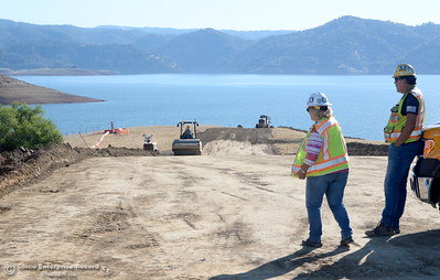 A road is under construction Wednesday on the lake side of the Oroville Dam spillway area, to provide traffic a route around the work area.  July 11, 2018.  (Bill Husa -- Enterprise-Record)