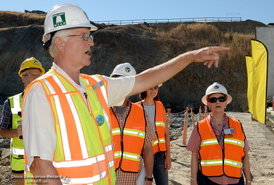 Tony Meyers, DWR project manager speaks to a group during a tour of ongoing construction at the Lake Oroville Dam Spillway area Wednesday, July 11, 2018.  (Bill Husa -- Enterprise-Record)