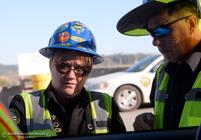 Security officers check each visitor to the Lake Oroville Dam Spillway area during a tour of ongoing construction at the Lake Oroville Dam Spillway area Wednesday, July 11, 2018.  (Bill Husa -- Enterprise-Record)