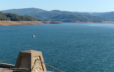 A single boat is seen near the Lake Oroville Dam during a tour of ongoing construction at the Lake Oroville Dam Spillway area Wednesday, July 11, 2018.  (Bill Husa -- Enterprise-Record)