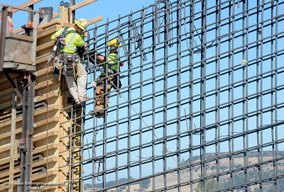 Construction workers climb a wall seen during a tour of ongoing construction at the Lake Oroville Dam Spillway area Wednesday, July 11, 2018.  (Bill Husa -- Enterprise-Record)