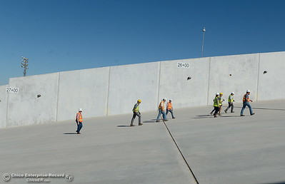 People walk inside of the spillway during a tour of ongoing construction at the Lake Oroville Dam Spillway area Wednesday, July 11, 2018.  (Bill Husa -- Enterprise-Record)