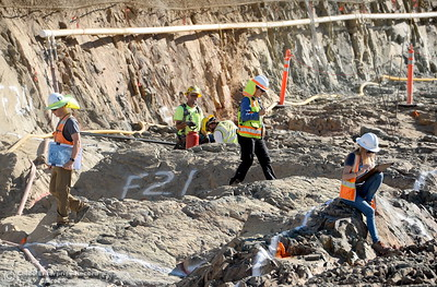Geologists map cracks as they check bedrock before concrete goes on a section of the upper chute of the spillway seen during a tour of ongoing construction at the Lake Oroville Dam Spillway area Wednesday, July 11, 2018.  (Bill Husa -- Enterprise-Record)