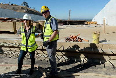 Erin Mellon, DWR Assistant of Public Affairs, left and Jeff Petersen, Senior Vice President Kiewit Executive Project Director look up the spillway during a tour of ongoing construction at the Lake Oroville Dam Spillway area Wednesday, July 11, 2018.  (Bill Husa -- Enterprise-Record)
