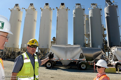 Second from left,  Jeff Petersen, Senior Vice President Kiewit Executive Project Director talks about a cement plant that operates in the spillway boat launch area parking lot seen during a tour of ongoing construction at the Lake Oroville Dam Spillway area Wednesday, July 11, 2018.  (Bill Husa -- Enterprise-Record)