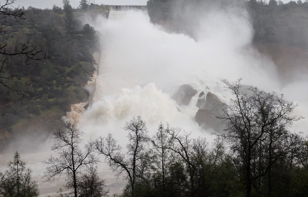 . The sound of raging water is almost visible while watching approx. 65,000 cfs of water spray into the air as it makes it\'s way down the damaged Lake Oroville Dam Spillway Friday Feb. 10, 2017. (Bill Husa -- Enterprise-Record)