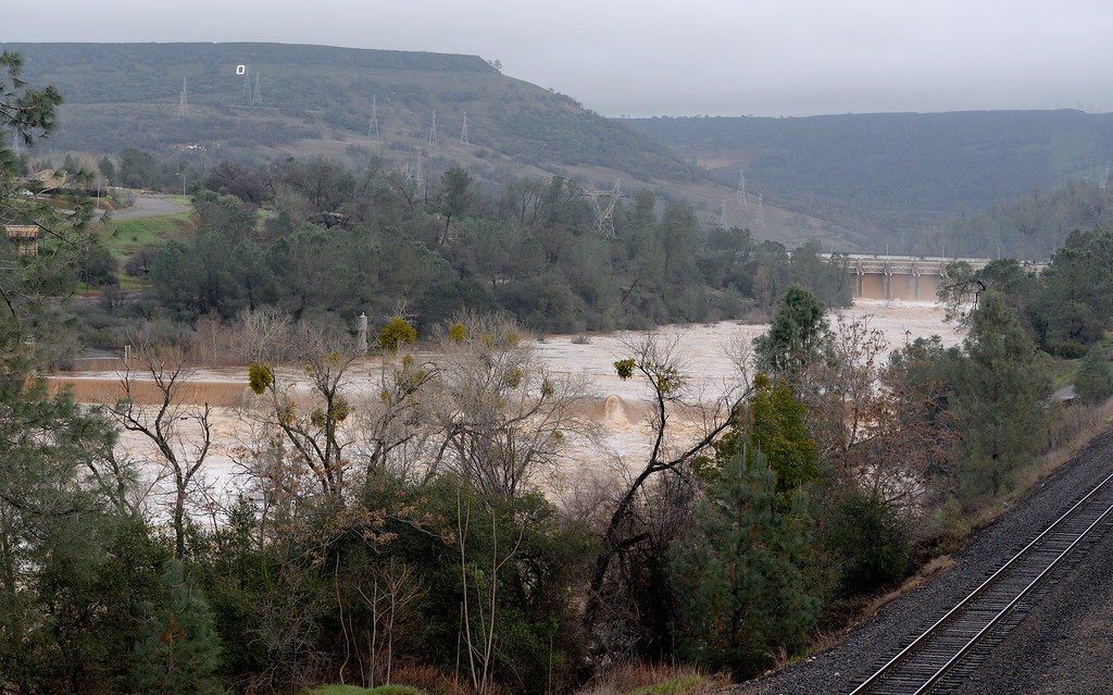 . A muddy Feather River is seen near the Fish Barrier Dam early Friday morning as approx. 65,000 cfs flows down the damaged Lake Oroville Dam Spillway Friday Feb. 10, 2017. (Bill Husa -- Enterprise-Record)
