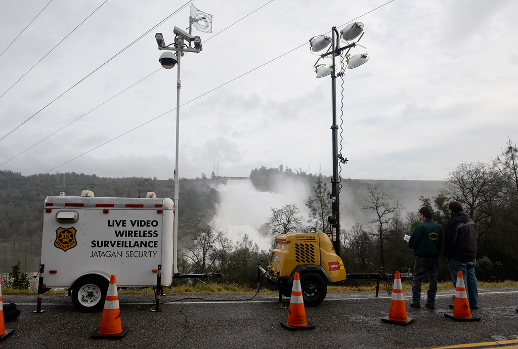 . A live video surveilance trailer keeps watch as approx. 65,000 cfs flows down the damaged Lake Oroville Dam Spillway Friday Feb. 10, 2017. (Bill Husa -- Enterprise-Record)