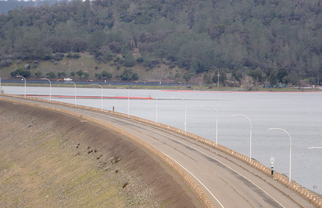 . The Spillway Launch Facility can be seen in the distance of this photo over the Lake Oroville Dam seen from the Vista Point Friday Feb. 10, 2017. (Bill Husa -- Enterprise-Record)