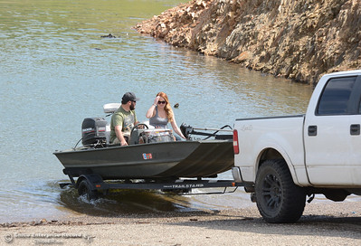 With Jake Dewey of Chico driving the pickup, Travis Strain and Jessica Stratton launch the boat onto Lake Oroville on Saturday, March 26, 2016, at Lime Saddle in Paradise, California. (Dan Reidel -- Enterprise-Record)