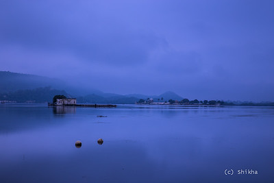 Lake Pichola at the break of dawn-  Soaked in rain, mist and clouds  Exposed for 13 secs @55 mm ISO 50, Aperture f/8.0