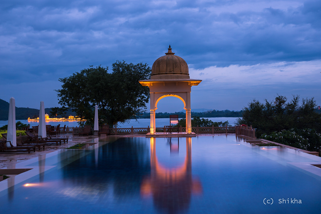 Lake Pichola and Jag Mandir in evening twilight -  It was raining, and the timer wasn't enough for me to run on the wet floor and reach the other side for a selfie. I did not have a remote switch either and had to settle with this.<br /> <br /> Exposed for 5 secs @39 mm ISO 100, Aperture f/8.0