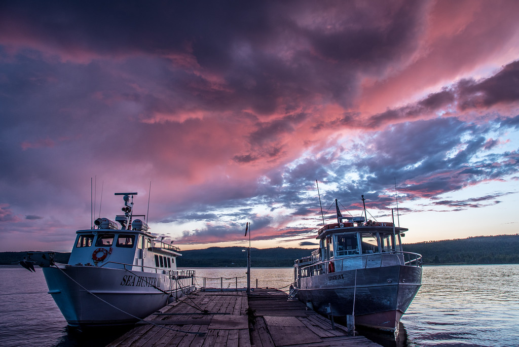 "SUPERIOR BOATS 7341<br /> <br /> ""A slightly surreal sunset over the Isle Royale Boats""<br /> <br /> The vessels ""Sea Hunter III"" and ""Voyageur II"" of the Grand Portage - Isle Royale Transportation Line docked in Grand Portage, MN."