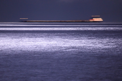 "SUPERIOR BOATS 9877  ""Night rider on the big lake""  One of the 1,000 foot ore carrier ships passes through the reflection of the moonlight on the waters of Lake Superior during the full moon on August 23, 2010."