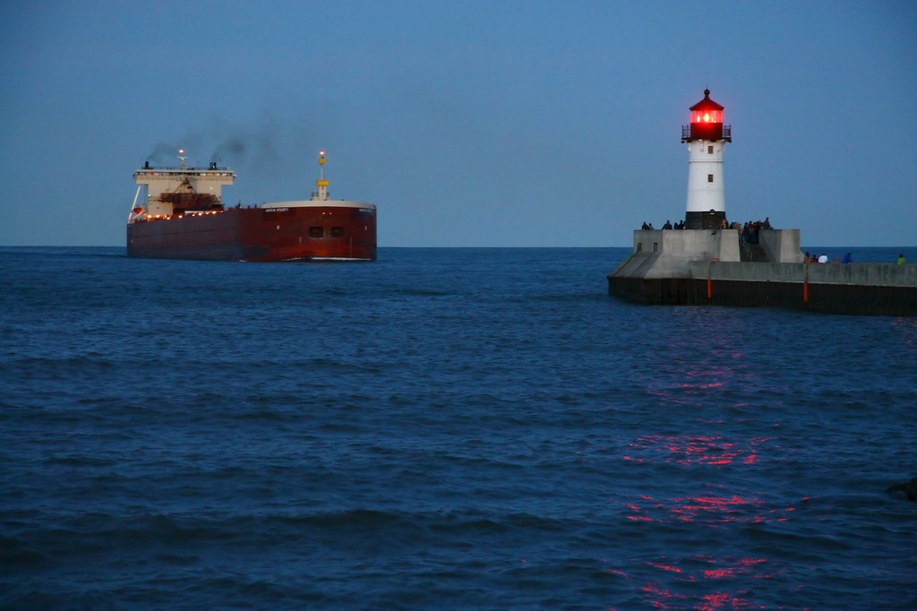 """SUPERIOR BOATS 1465<br /> <br /> """"Evening Approach, Duluth ship canal""""<br /> <br /> The American Steamship Company's """"American Integrity"""" approaches the Duluth ship canal at dusk."""
