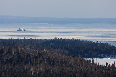 "SUPERIOR BOATS 4438  ""USCG Cutter ""Alder"" heading home from Thunder Bay""  The ""Alder"" passes between the Susie Islands and Isle Royale on its way back to Duluth after breaking ice in the Thunder Bay harbour."