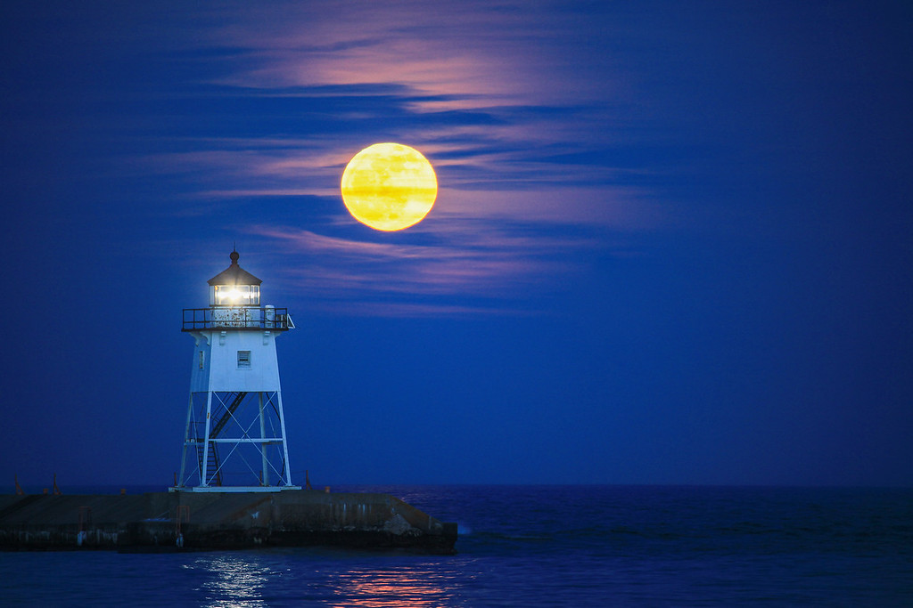 "SUPERIOR SPRING 2220<br /> <br /> ""April moonrise over the Grand Marais Lighthouse""<br /> <br /> Grand Marais, MN"