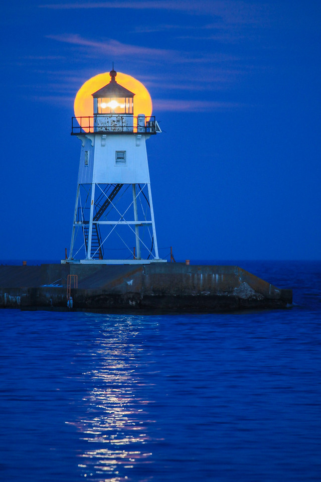 "SUPERIOR SPRING 2207  ""April moonrise over the Grand Marais Lighthouse""  Grand Marais, MN"