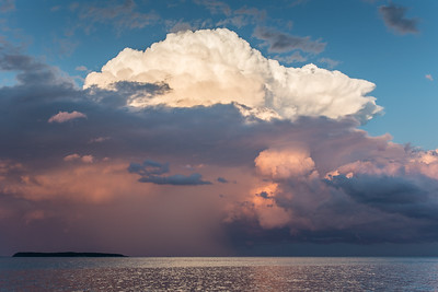"SUPERIOR SUMMER 9115  ""An awesome end to a beautiful day""  A storm cloud sunset over Lucille Island in Grand Portage, MN."