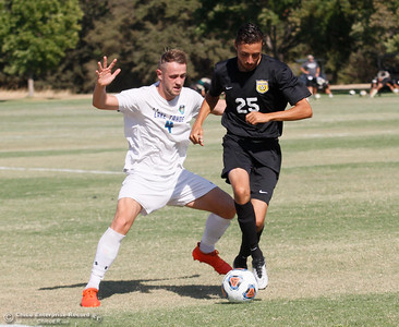 Butte College's Dylan Hall works his way around Lake Tahoe's defensive player Daniel Culverwell during a soccer game Tuesday September 27, 2016 in Oroville, Calif. (Emily Bertolino -- Mercury Register)