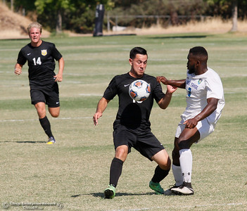 Butte College's David Gomez chests the ball with Lake Tahoe's Courtney Lewis playing tough defense during a soccer game Tuesday September 27, 2016 in Oroville, Calif. (Emily Bertolino -- Mercury Register)