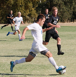 Butte College's Adam Olsson (22) rushes to play defense against Lake Tahoe College's Miguel Diaz Ortega during a soccer game Tuesday September 27, 2016 in Oroville, Calif. (Emily Bertolino -- Mercury Register)