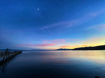 Sunset and pier view of Lake Tahoe from Tahoe City Beach