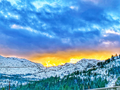 Sunset view of snow capped mountains in Donner, Sierra Nevada Mountains.