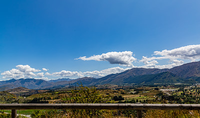 Beautiful valley with backdrop of the Southern Alps , Ka tiritiri o te Moana,  outside  Queenstown, Otago, South Island, New Zealand, on the way to Wanaka on a crazy beautiful sky day