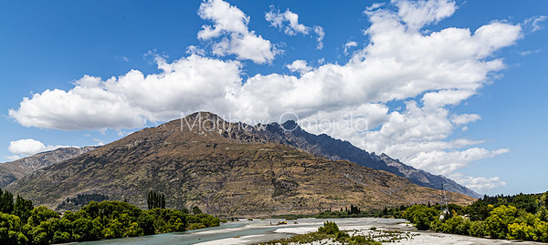 Panorama, river bed, Southern Alps , Ka tiritiri o te Moana,  just outside  Queenstown, Otago, South Island, New Zealand, on the way to Wanaka on a crazy beautiful sky day