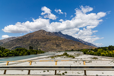 A river bed, Southern Alps , Ka tiritiri o te Moana,  just outside  Queenstown, Otago, South Island, New Zealand, on the way to Wanaka on a crazy beautiful sky day