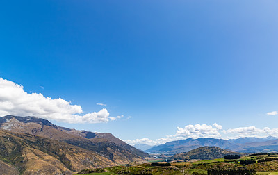 Valley, Southern Alps , Ka tiritiri o te Moana,  just outside  Queenstown, Otago, South Island, New Zealand, on the way to Wanaka on a crazy beautiful sky day