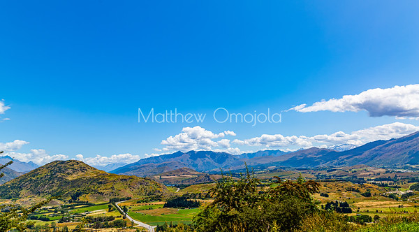 Beautiful valley with farmlands backdrop of Southern Alps , Ka tiritiri o te Moana,  just outside  Queenstown, Otago, South Island, New Zealand, on the way to Wanaka on a crazy beautiful sky day
