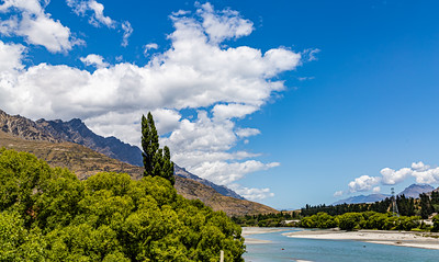 River bed, Southern Alps , Ka tiritiri o te Moana,  just outside  Queenstown, Otago, South Island, New Zealand, on the way to Wanaka on a crazy beautiful sky day