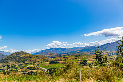 Farm lands, valley, Southern Alps , Ka tiritiri o te Moana,  just outside  Queenstown, Otago, South Island, New Zealand, on the way to Wanaka on a crazy beautiful sky day