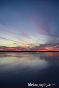 A brilliant sunset in January on frozen Lake Minnetonka, MN