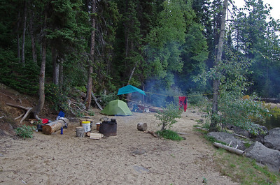 "setting up camp on ""my"" little island; on a sandy beach, protected from the wind"