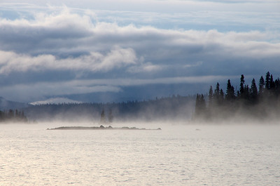 the mist rising over the water