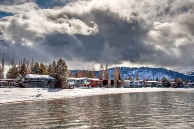 lake-shore-houses-clouds